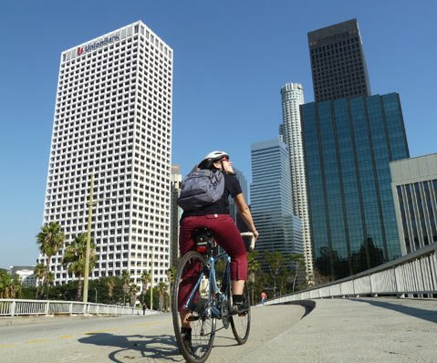 Big city commuter Sarah Eberhardt takes in the sunshine and fresh air on her morning ride to work.