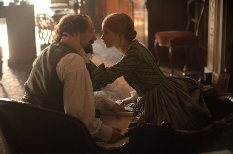 Ralph Fiennes (left) and Felicity Jones star as Charles Dickens and his young mistress in <em>The Invisible Woman</em>.