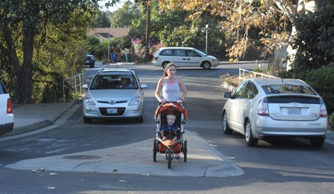 <b>THREADING THE NEEDLE:</b>  Emily Rorden and son Jace make their way across the sidewalk-free Yanonali Street bridge during morning rush hour. Neighbors have been asking City Hall for a sidewalk for nearly 15 years. Monday night, the City Council finally obliged.