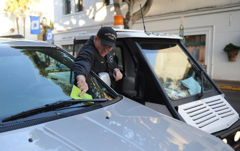 <b>NAILED:</b>  A violator is ticketed by one of the police department's 14 parking enforcement officers.