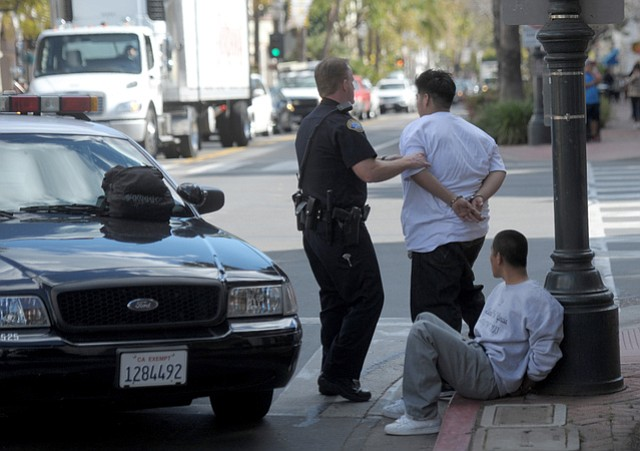 Two of three people detained at State and Carrillo.