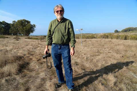 Dar Roberts, head of UCSB Geography, stands amid the dry landscape at Coal Oil Point where climate change information is being gathered.