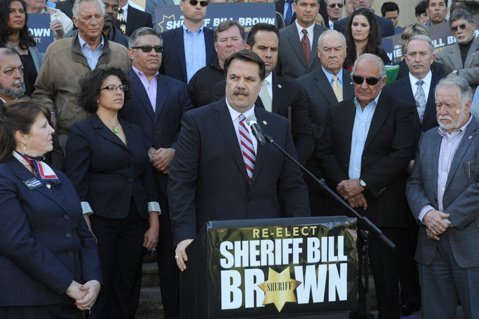 <b>FEELIN' GOOD:</b>  Sheriff Bill Brown shares a laugh with supporters during Monday's press conference to announce his bid for reelection.