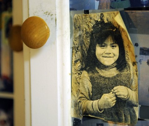 "<b>SANTA BARBARA GIRL:</b>  This photo of a young ""Julia"" curls off a cabinet door in her family's home. It wasn't until she was in 8th grade that she learned she was born in Mexico."