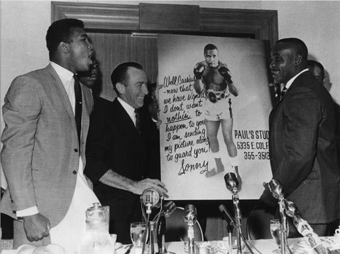"At the contract signing for the first Ali-Liston fight, Sonny Liston and his manager, Jack Nilon, presented Muhammad Ali with a poster that read: ""Well, Cassius — now that we have signed, I don't want nothin to happen to you — I am sending my picture along to guard you! Sonny."" Ali, called Cassius Clay back in 1963, responded by punching the poster, to which Liston cautioned him, ""Don't hurt your hand, boy."""