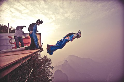 <b>WING MAN:</b>  Wingsuit pilots attempt to fly through a naturally occurring archway near China's Tianmen Mountain in <em>Heaven's Gate</em>.