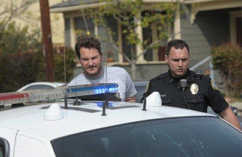 An unidentified man is arrested after brandishing a gun on De La Vina Street
