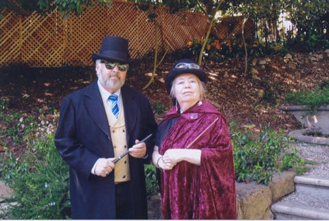Clad in a cloak, large top hat, and thick glasses, Morbidia Schleppenphal (right) hosts wizard-themed events.