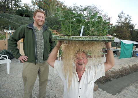 Randy Turner (left) and Kevin Childerley, founders of Santa Barbara Aquaponics. Childerley holds one of the system's soil-less plant rafts