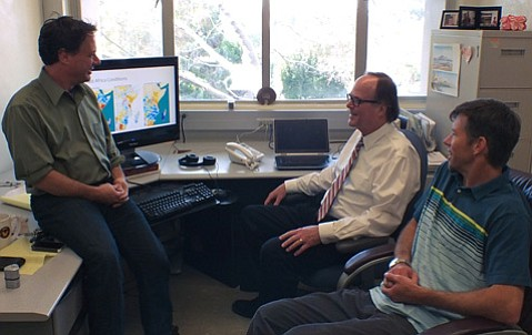 Climate Hazards Group researchers (from left) Drs. Chris Funk, Joel Michaelsen, and Greg Husak discuss a satellite image of East Africa's climate conditions. Remote sensing data of rainfall and other climate patterns have aided in drought predictions in parts of the world that are vulnerable to crop failure.