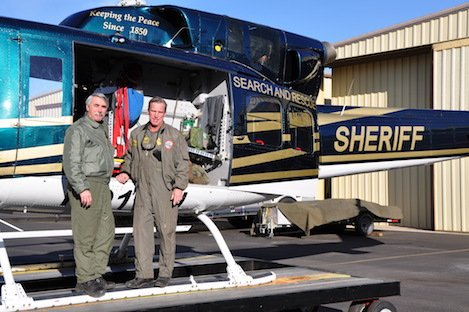 Sheriff Air Support Deputies Jon Simon and Gregg Weitzman next to Chopper 3, which they made possible through their Project Rescue Flight non-profit.