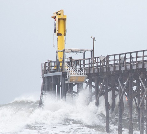 Gaviota Pier now ends at the boat hoist. Heavy surf threatens to destroy more of the pier tonight, including the boat launch facilities.