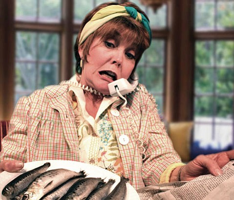 <b>APPETIZING:</b>  Ann Dusenberry serves up a platter of fish in the wild Michael Frayn Farce <i>Noises Off</i>.