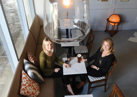 <b>QUAFFING COUPLE:</b>  Friends Jamie Heer (left) and Tucker Huget serve artisan-minded wine and beer at their new bar inside San Marcos Plaza.