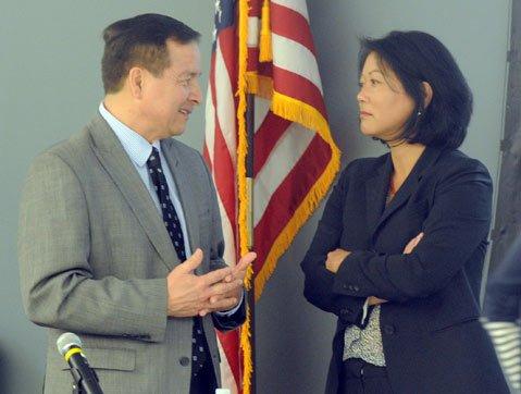 <b>Huddle:</b>  Budget Director Tom Alvarez speaks with county CEO Mona Miyasato.