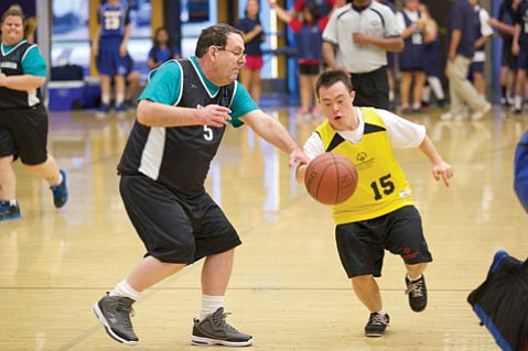 <b>TEAM WORK:</b> Last Sunday, 38 teams from San Luis Obispo to Burbank competed in the daylong, 14th annual Special Olympics Regional Basketball Tournament at UCSB's Thunderdome. Shouts and cheers punctuated the clamor of floor play whenever a shot found the hoop. <b>Pictured:</b> Ventura went toe-to-toe against Santa Clarita.