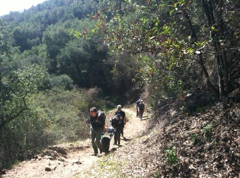 Search and Rescue members remove the body of the deceased hiker.