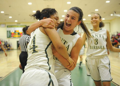 <b>VICTORY:</b> SBHS's Jocelin Petatan (left) and Amber Melgoza embrace after besting Mount Miguel.