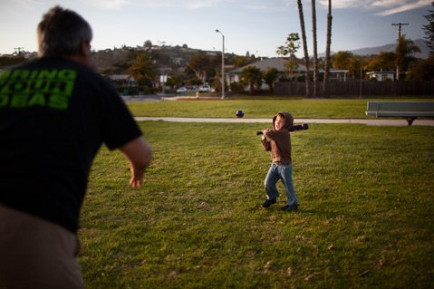 Erik Chen practices his baseball skills with his dad Leonard at Shoreline Park.