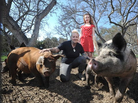 "<b>PIGS AND VINEGAR:</b> Crystal ""Chef Pink"" DeLongpre (left) and her wife, Courtney Rae DeLongpre, are opening a new restaurant focused on smoked meats and fermented foods."
