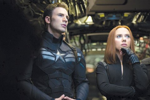 <b>A STAR IS REBORN:</b>  In <i>Captain America: Winter Soldier</i>, the First Avenger (Chris Evans) reteams with Black Widow (Scarlett Johansson) to face a foe from his past.