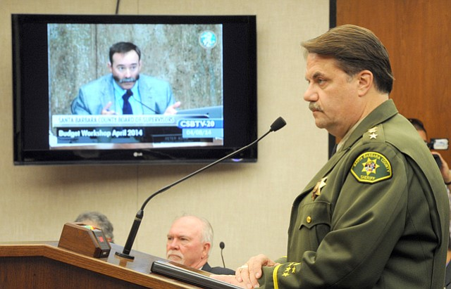 "<b>BUTTING HEADS:</b> Sheriff Bill Brown listened to Supervisor Peter Adam speak at a budget meeting on Tuesday. The two are at odds when it comes to Adam's Measure M, which Brown and others have said ""would cripple law enforcement."""