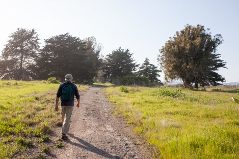 Hiker walks along what will become a part of the CA Coastal Trail if the Paradiso del Maré project comes to fruition.
