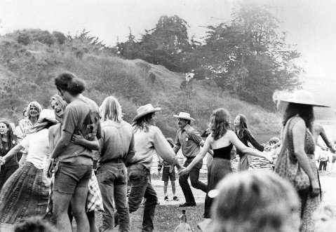 <b>JUST FOLKS:</b> Luis Goena (center) led dancers, here at the Fiddlers' Convention at UCSB, in happy, hippy, social steps.