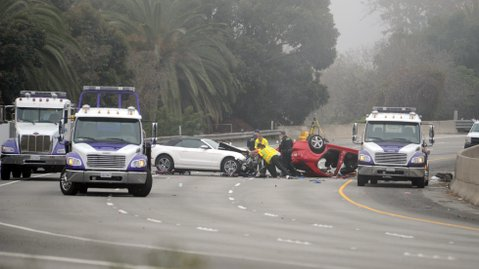 Southbound 101 closed at Castillo Street as CHP and tow truck drivers clear two of the vehicles that were involved in crash at 12:45 a.m. resulting in three deaths and one person hospitalized. (April 21, 2014)