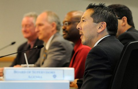 <b>SPEAKING OF SOLUTIONS:</b> Dr. Takashi Wada and colleagues explain to the Board of Supervisors what ADMHS is doing to fix its long-festering problems.