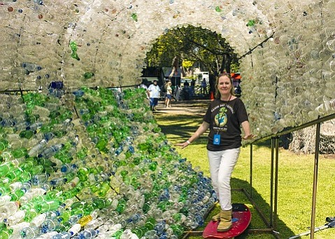 "CEC's Sigrid Wright ""surfing"" a wave made of single-use plastic bottles at the 2013 Santa Barbara Earth Day Festival."