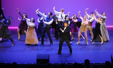 """<b>YOUNG GUNS:</b> Host Jamie Torcellini and 12 area high school actors and actresses opened Monday's competition with """"There's No Business Like Show Business."""""""
