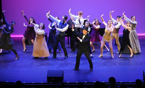 "<b>YOUNG GUNS:</b> Host Jamie Torcellini and 12 area high school actors and actresses opened Monday's competition with ""There's No Business Like Show Business."""
