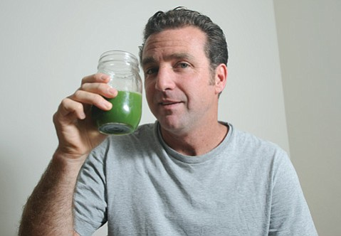 <b>GREEN MACHINE: </b> The author, sippin' on the prescribed fasting goo, reports that his cleanse went cleanly.