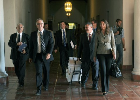 Prosecutors leave the courthouse after the first day of the gang injunction trial