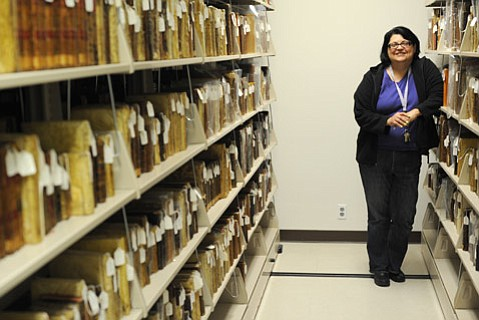<b>A TIME GONE:</b> Monica Orozco (pictured) keeps a watchful eye over the historic tomes in the S.B. Mission Archive-Library.
