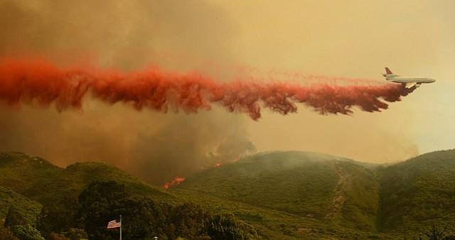 The DC-10 dropping a line of Phos-Chek retardant on the vegetation fire in the San Miguelito Canyon area south of Lompoc (May 13, 2014)