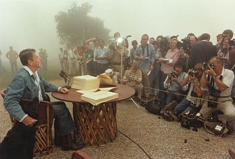 Pres. Reagan meets with the press at Rancho del Cielo after signing his 1981 budget, which prioritized tax cuts, reductions in domestic discretionary spending, and increased military spending.