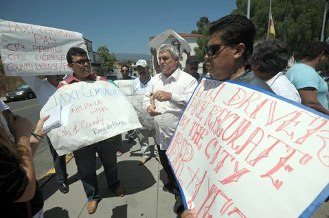 Taxi drivers protest at De la Guerra Plaza that ride-sharing companies Uber and Lyft enjoy an unfair advantage.