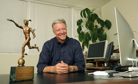 "Simon Fox in his Santa Barbara office with a coveted International Health and Medical Media ""Freddie"" award from 2004"