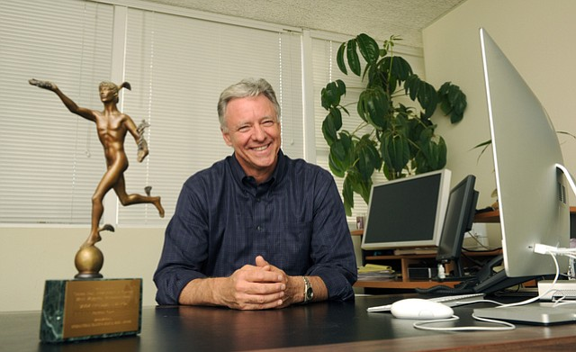 """Simon Fox in his Santa Barbara office with a coveted International Health and Medical Media """"Freddie"""" award from 2004"""