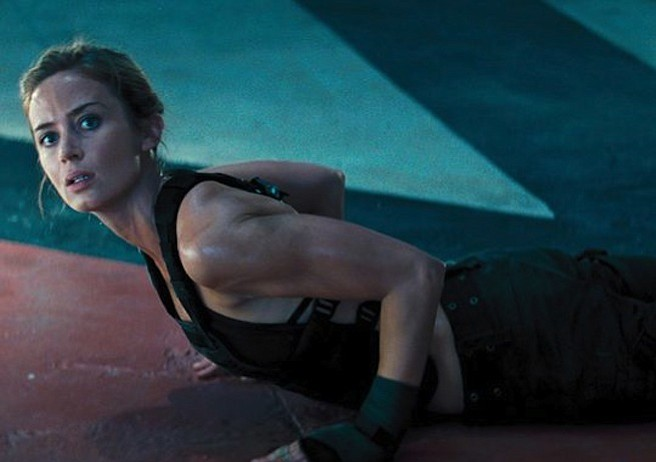 RAW POWER: Emily Blunt packs a punch as the tough warrior opposite Tom Cruise's sniveling military spokesperson in <em>Edge of Tomorrow</em>.