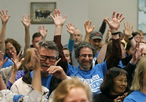 Supporters of the ballot measure, wearing blue shirts, waved their hands in the air in agreement with comments made on Friday.