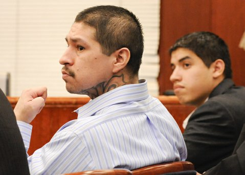 Raymond Daniel Macias, left, and his co-defendant Luis Alfredo Almanza listen as the jury is given instructions after they reached verdicts on some of the counts against them. (June 20, 2014)