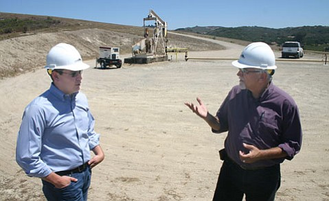 <b>CAN YOU DIG IT? </b> Santa Maria Energy Vice President of Operations Kevin Yung (left) and Public and Government Affairs Manager Bob Poole discuss operations at the company's oil field.