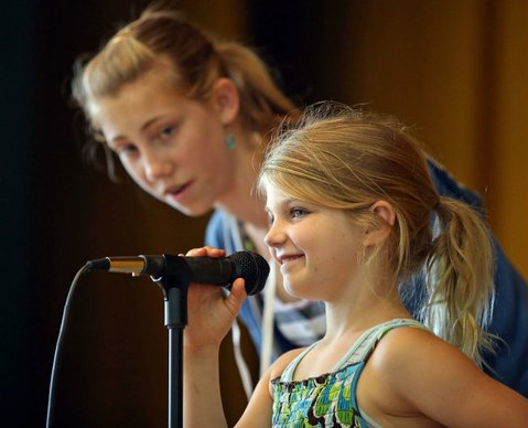 START 'EM YOUNG: Girls Rock S.B. intern Abby Jackson-Gain (left) coaches vocalist Mia.
