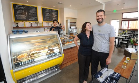 <b>MR. & MRS. CHEESE:</b>  After extensive work, Michael and Kathryn Graham are now serving baked goods, coffee, cheese, and much more in their expanded C'est Cheese.