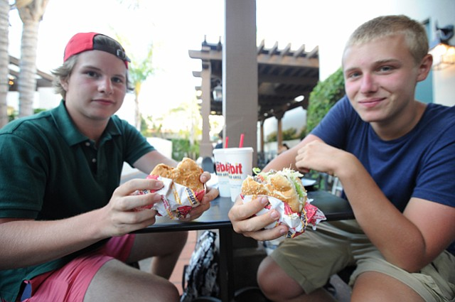 Joaquin Del Rio (left), from Spain, and Giovanni Ludergnani, from Italy, enjoy burgers from the recently nationally recognized Habit Burger Grill.