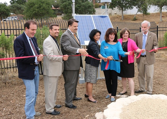 County officials, including Sheriff Bill Brown (third from left) and Supervisor Janet Wolf (third from right), joined seismologist Lucy Jones (in pink) on Thursday for a ribbon-cutting of one of the seven new earthquake early-warning sensor stations in the county.