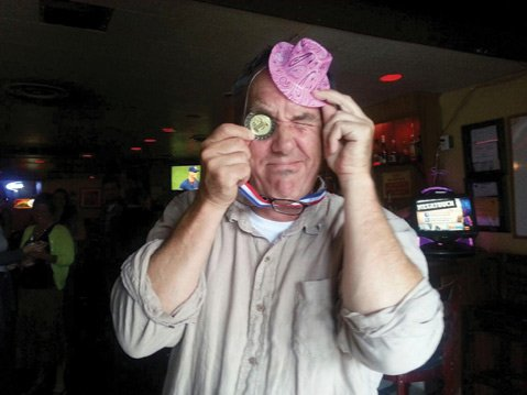 Paul Wellman mugs with his 1st place medal and awarded party hat from AAN.